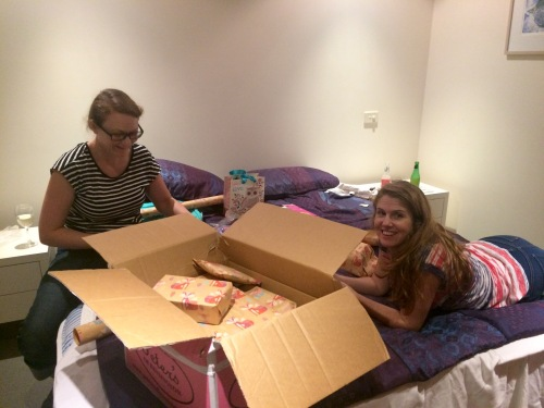 Lauren and Sandy wrapping Charlize's presents